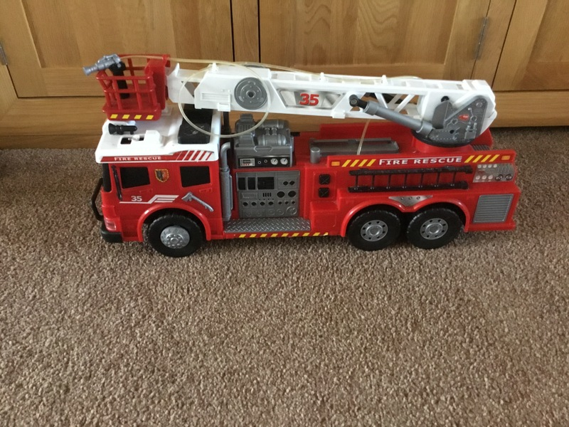 Toy fire engine with noises and flashing lights