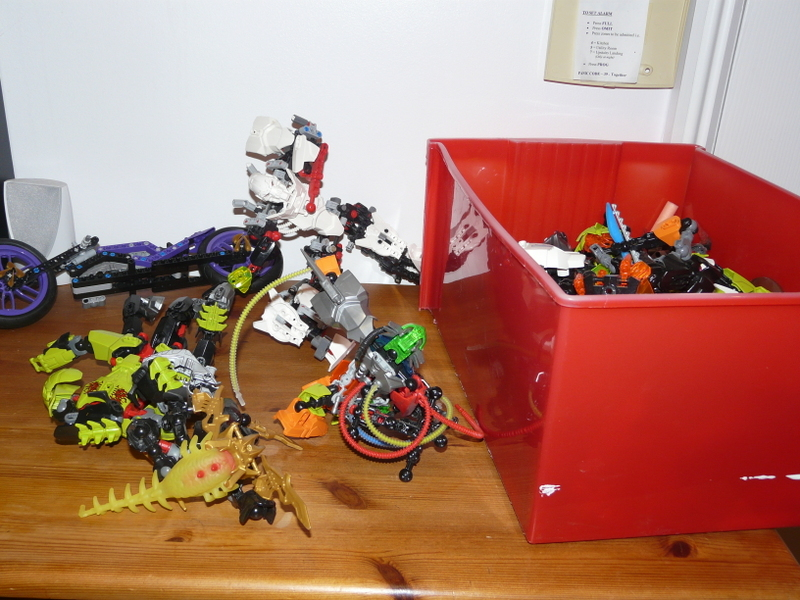 Box of Lego transformers with spare parts