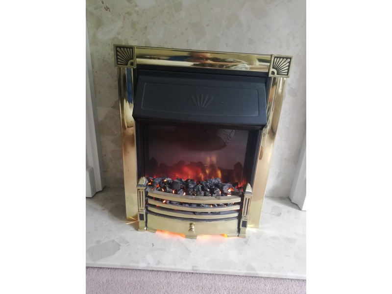 Electric Fire with coal flame effect.