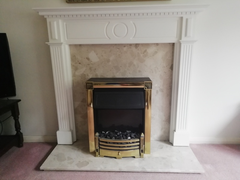Fireplace with stone / marble type base and backplate.
