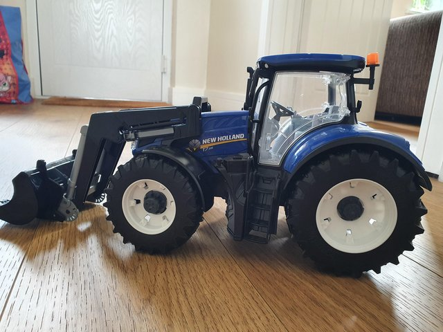 New Holland T with trailer & Hay Bales